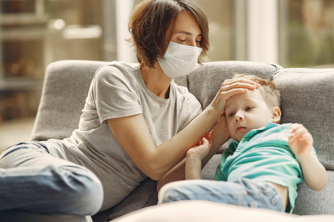 Parent wearing mask to prevent catching COVID19